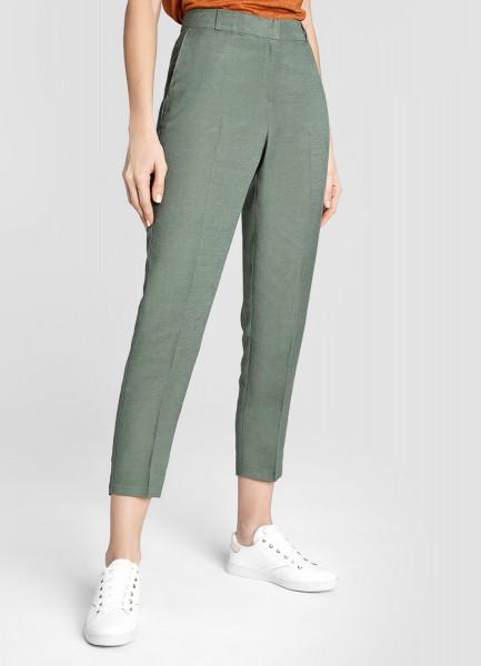 Зауженные брюки изо льна фото
