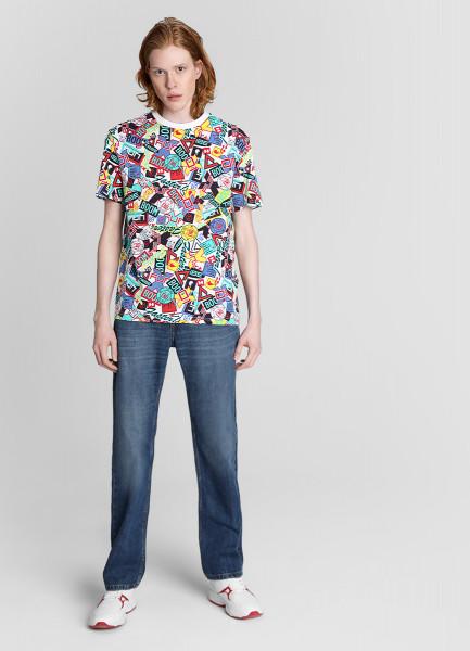 Свободные джинсы с умеренной стиркой фото