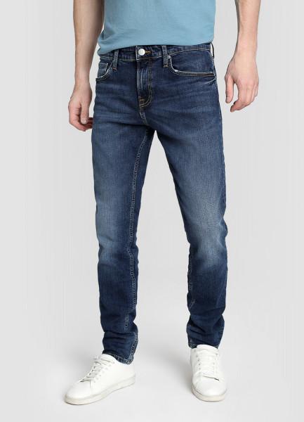 Зауженные джинсы с потёртостями фото