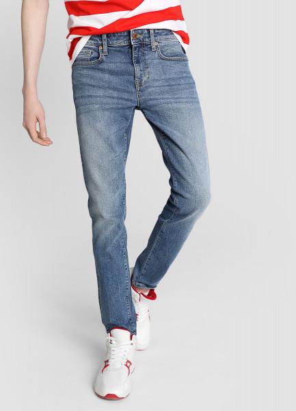 Узкие джинсы с потёртостями фото
