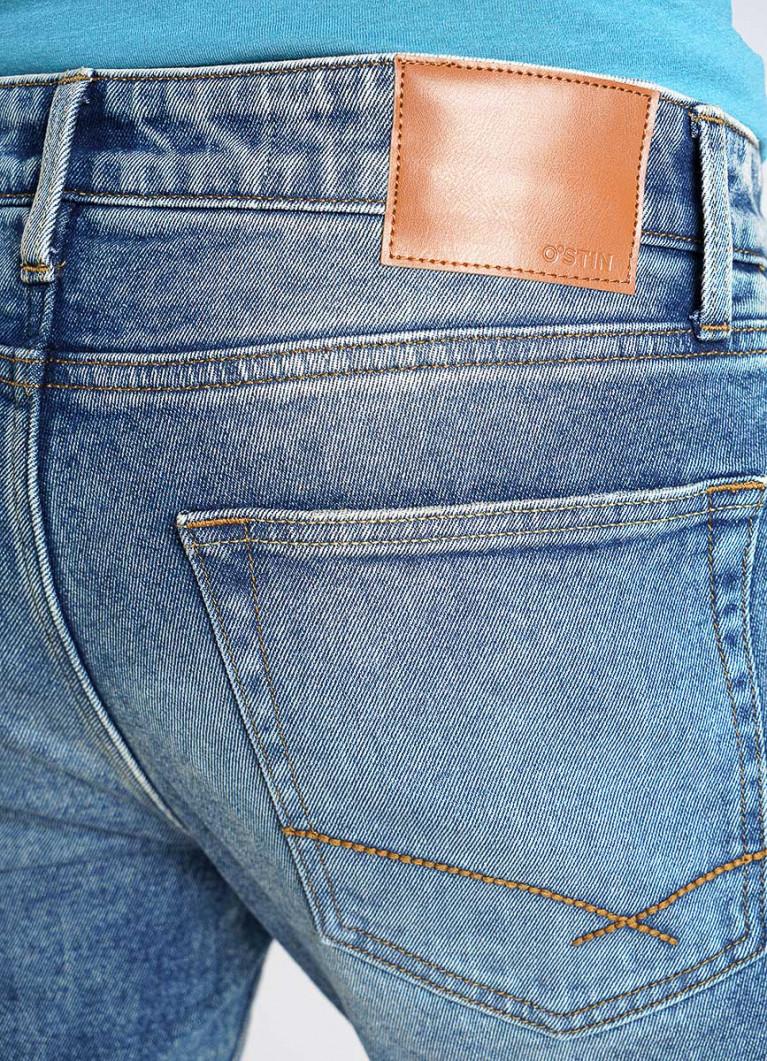 Синие зауженные винтажные джинсы