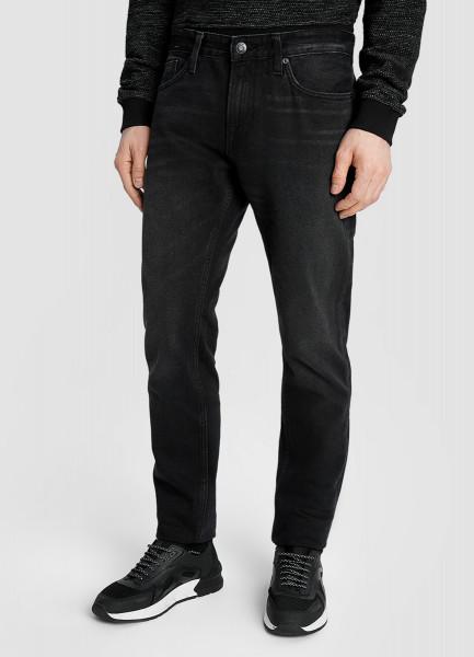 Чёрные зауженные джинсы с потёртостями