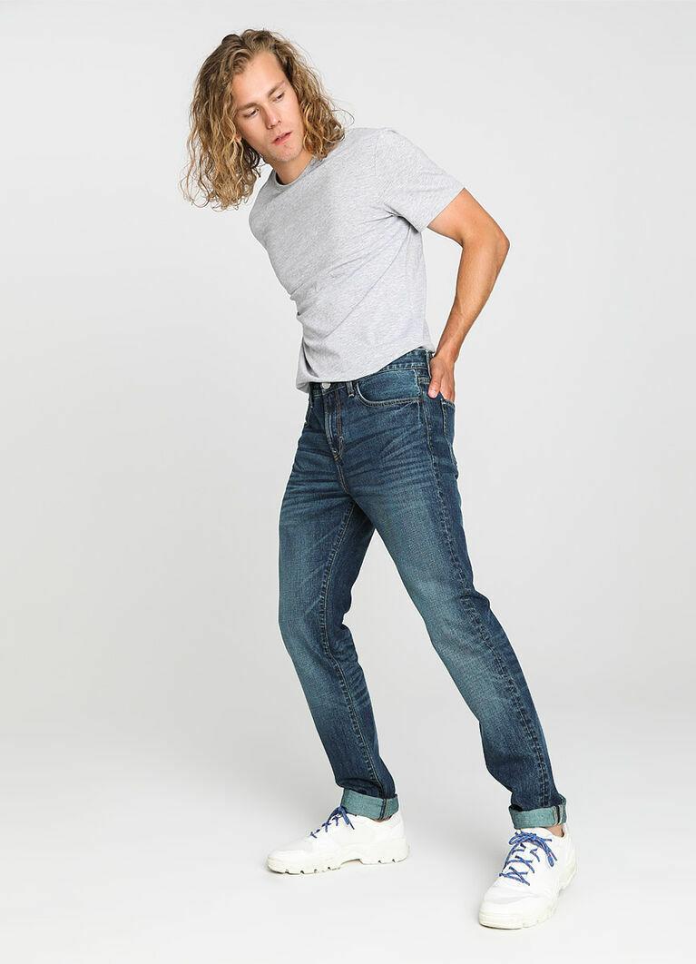 Тёмно-синие зауженные джинсы