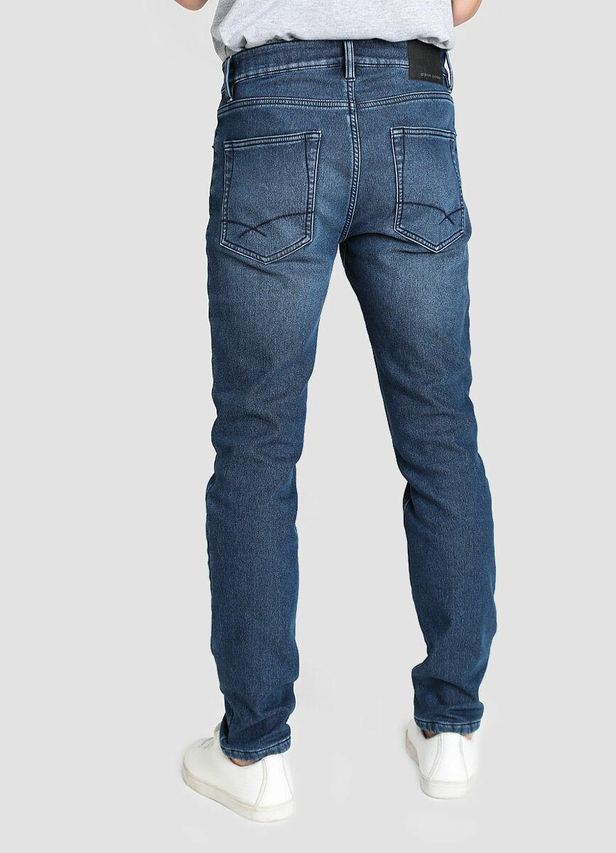 Утеплённые зауженные джинсы